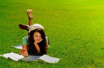 Studying while laying on the grass might not be an effective UNISA study practice.